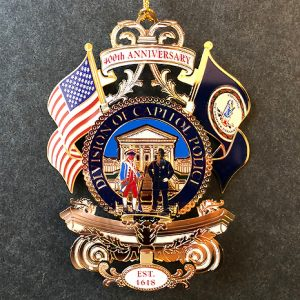 Seventh in a series of collectible ornaments, the 2018 Official Capitol Square Ornament celebrates The 400th Anniversary of the Capitol Police, a beloved institution on Capitol Square.
